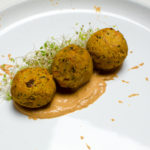 Vegan Sweet Potato Quinoa Falafel with Roasted Pepper Walnut Dressing